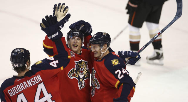 Florida Panthers' Brad Boyes (24) and Erik Gudbranson (44) celebrate with Scottie Upshall (19) after Upshall scored against the Anaheim Ducks during the second period of an NHL hockey game in Sunrise, Fla., Tuesday, Nov. 12, 2013. (AP Photo/J Pat Carter)