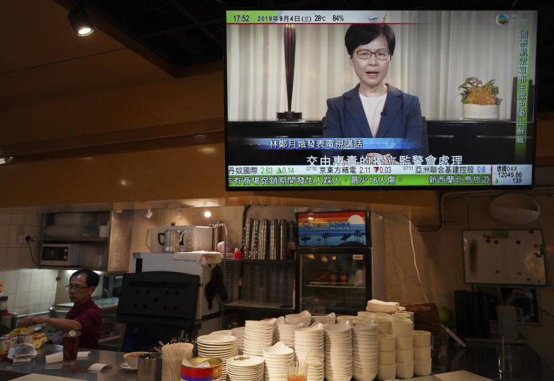 Hong Kong Chief Executive Carrie Lam, seen in a telecast, makes an announcement in Hong Kong, on Wednesday, Sept. 4, 2019. Chief Executive Lam has announced the government will formally withdraw an extradition bill that has sparked months of demonstrations in the city, bowing to one of the protesters' demands. The bill would have allowed Hong Kong residents to be sent to mainland China for trials. It sparked massive protests that have become increasingly violent and caused the airport to shut down earlier this month.(AP Photo/Vincent Yu)