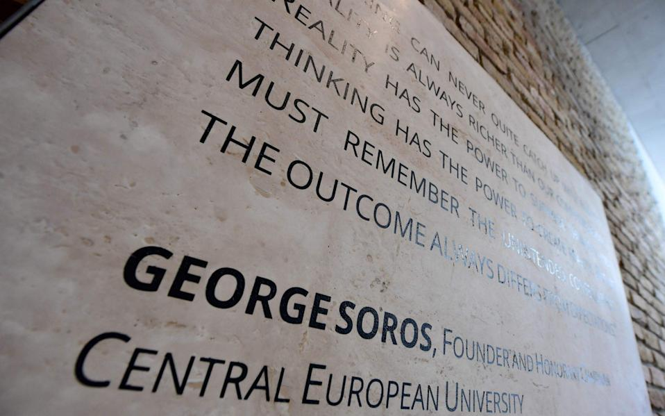 A quote of the founder of the English-language Central European University (CEU) Hungarian born American businessman George Soros is seen at the main entrance in Budapest - Credit: AFP