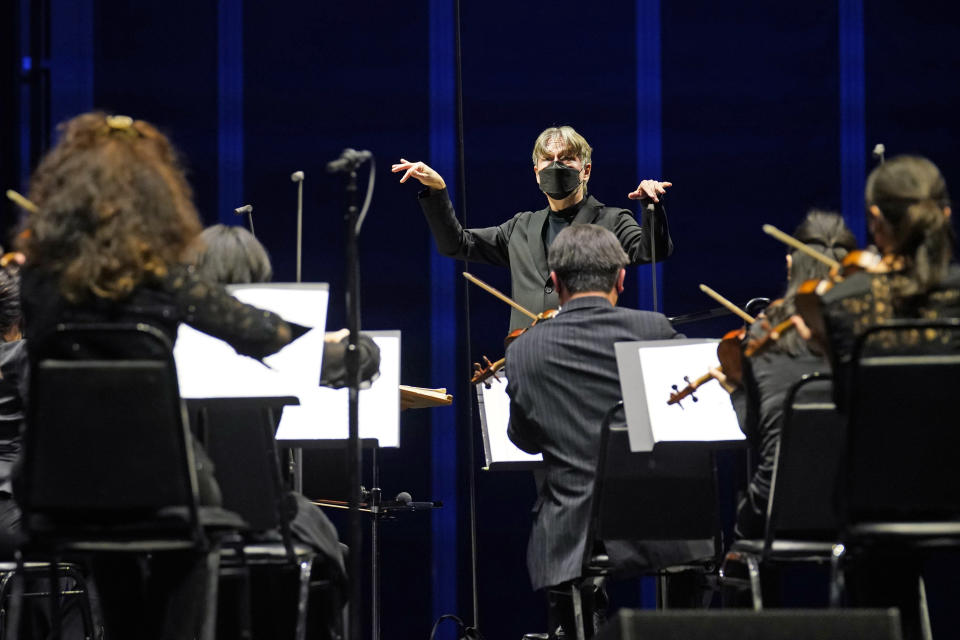 CORRECTS SPELLING OF FIRST NAME TO ESA INSTEAD OF ESSA - Guest conductor Esa-Pekka Salonen, music director of the San Francisco Symphony and principal conductor of London's Philharmonia Orchestra, leads the New York Philharmonic as the orchestra perform together before a live audience of 150 spectators for the first time since March 10, 2020, at The Shed in Hudson Yards, Wednesday, April 14, 2021, in New York. (AP Photo/Kathy Willens)
