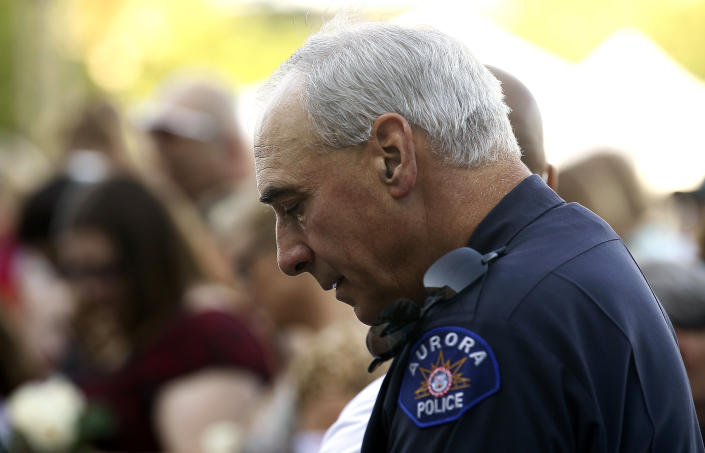 Aurora police chief Dan Oates prays at a ceremony marking the one-year anniversary of the Century theater shootings in Aurora, Colorado July 20, 2013. (Photo: Rick Wilking/Reuters)