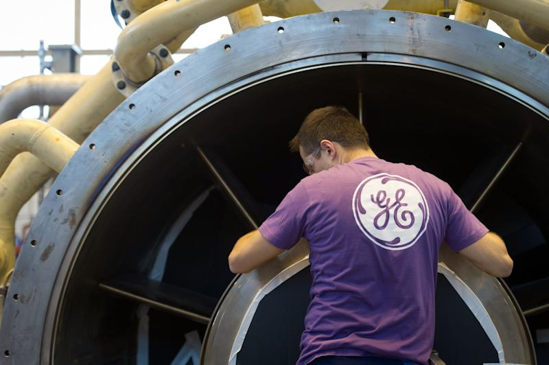 An employee of US multinational General Electric (GE) works on a gas turbine at the GE plant in Belfort, eastern France, on October 27, 2015. (Photo: SEBASTIEN BOZON/AFP/Getty Images)