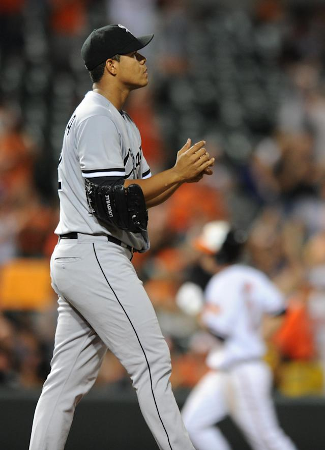 Chicago White Sox pitcher Jose Quintana walks to the mound after giving up a solo home run to Baltimore Orioles' J.J. Hardy, behind, in the fifth inning of a baseball game, Thursday, Sept. 5, 2013, in Baltimore.(AP Photo/Gail Burton)