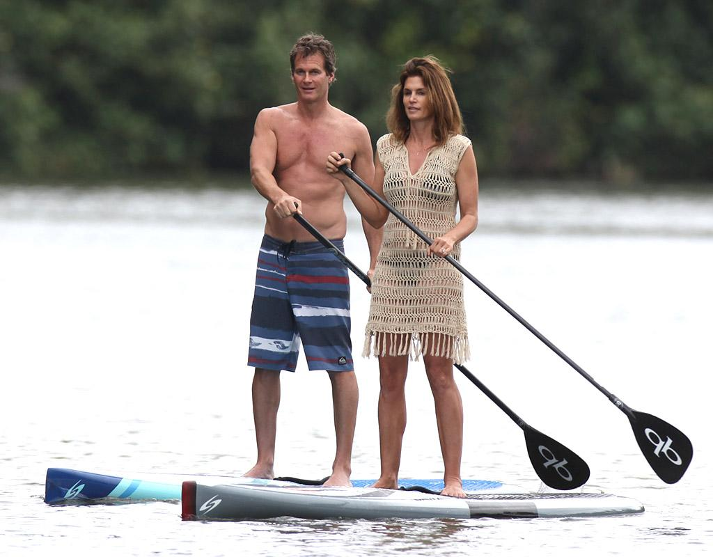 EXCLUSIVE: Cindy Crawford goes stand up paddle boarding up a river while vacationing in Hawaii.