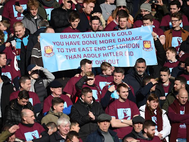 West Ham fans accuse club owners of doing 'more damage to east London than Hitler' in protest banner