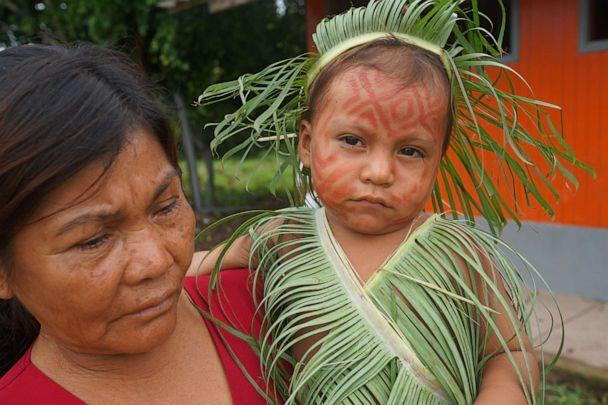 PHOTO: An indigenous Kakataibo grandmother and her grandchild in Peru's Ucayali region. Last year saw an uptick in deforestation in this dense jungle area. (Neil Giardino/ABC News)