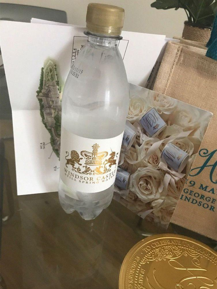 A water bottle featuring a royal monogram and the location of Prince Harry and Meghan Markle's wedding