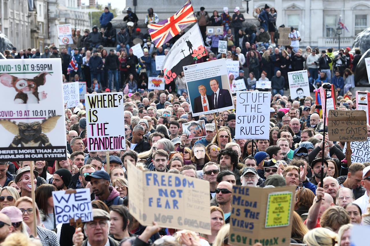 People take part in a 'We Do Not Consent' rally at Trafalgar Square in London, organised by Stop New Normal, to protest against coronavirus restrictions.