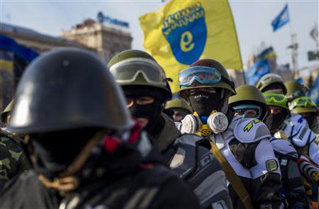 Members of various anti-government paramilitary groups gather at Independence Square during show of force in Kiev