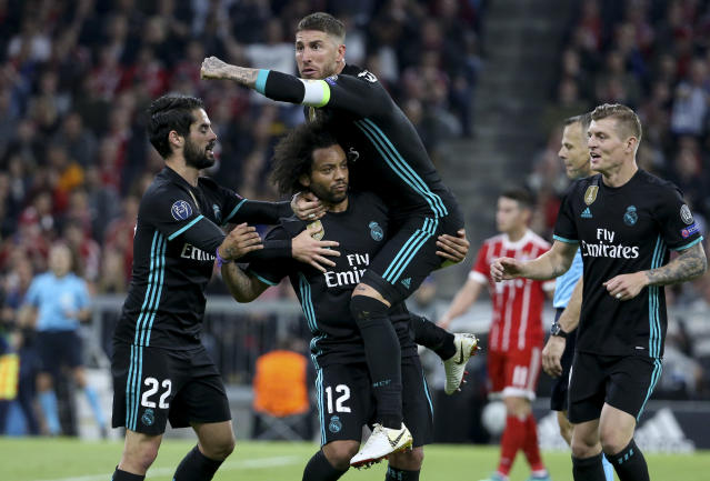 Real Madrid players celebrate Marcelo's goal in the first half of their Champions League semifinal first leg against Bayern Munich. (Getty)