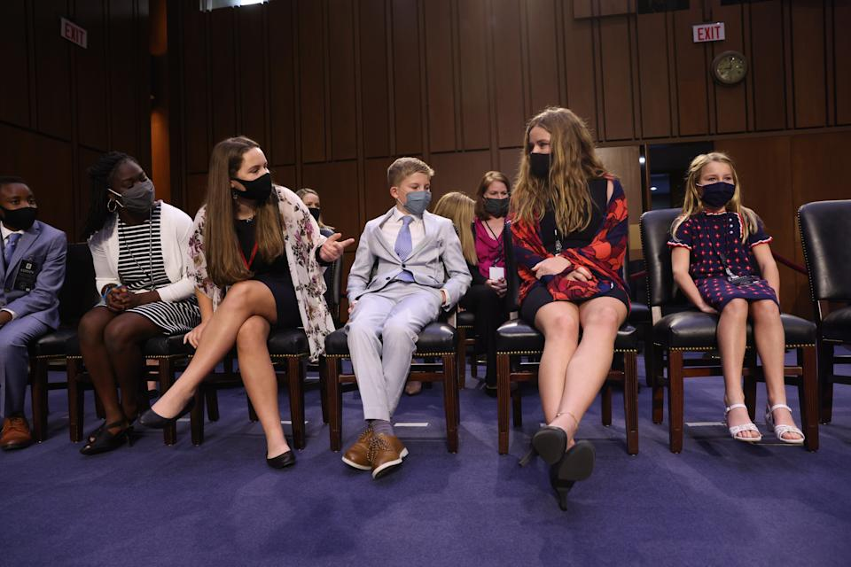 Family members of Supreme Court nominee Judge Amy Coney Barrett are seated prior to Barrett testifying before the Senate Judiciary Committee on the third day of her Supreme Court confirmation hearing Wednesday.