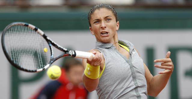 Italy's Sara Errani returns the ball during the quarterfinal match of the French Open tennis tournament against Germany's Andrea Petkovic at the Roland Garros stadium, in Paris, France, Wednesday, June 4, 2014. (AP Photo/Darko Vojinovic)
