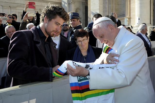 Pope Francis receives the UCI Road World Champion jersey from cycling world champion Peter Sagan of Slovakia at the end of general audience at the Vatican, January 24, 2018. Osservatore Romano/Handout via REUTERS ATTENTION EDITORS - THIS IMAGE WAS PROVIDED BY A THIRD PARTY
