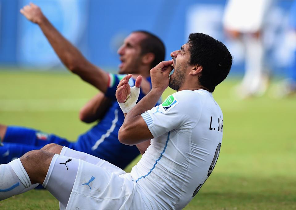 Luis Suarez reacts after his infamous bite at the 2014 World Cup. Surely there would be a repeat in 2018 … right? (Getty)