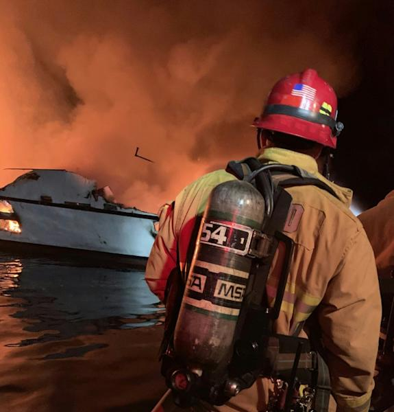 In this photo released by the Ventura County Fire Department, firefighters attempt to extinguish a blaze on a boat off the coast of Santa Cruz Island, California; it later sank (AFP Photo/HO)