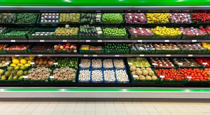 Fresh fruits and vegetables on the shelf in the supermarket