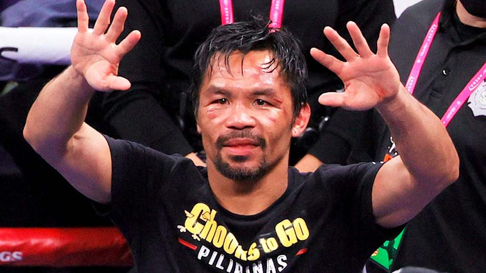 Legendary boxer Manny Pacquiao (pictured) waves at the crowd.