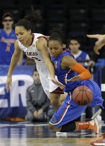 Florida forward Christin Mercer (25) and Arkansas forward Jhasmin Bowen (42) fight for the ball during the first half of their NCAA college basketball game in the Southeastern Conference tournament, Thursday, March 7, 2013, in Duluth, Ga. (AP Photo/John Bazemore)