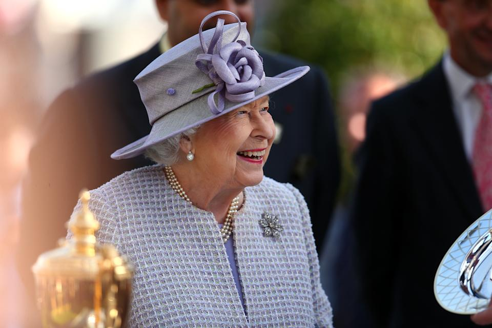 ASCOT, ENGLAND - OCTOBER 19: Queen Elizabeth II presents Sean Levey winner of The Queen Elizabeth II Stakes with his trophy during the QIPCO British Champions Day at Ascot Racecourse on October 19, 2019 in Ascot, England. (Photo by Charlie Crowhurst/Getty Images)