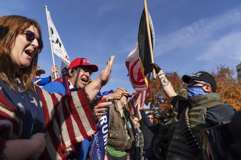 <p>Trump supporters (left) demonstrated against the election results while facing counter-protestors at the Capitol in Lansing, Michigan, on Saturday.</p> <p>Michigan was one of several key states that swung for Biden four years after voting for Trump.</p>