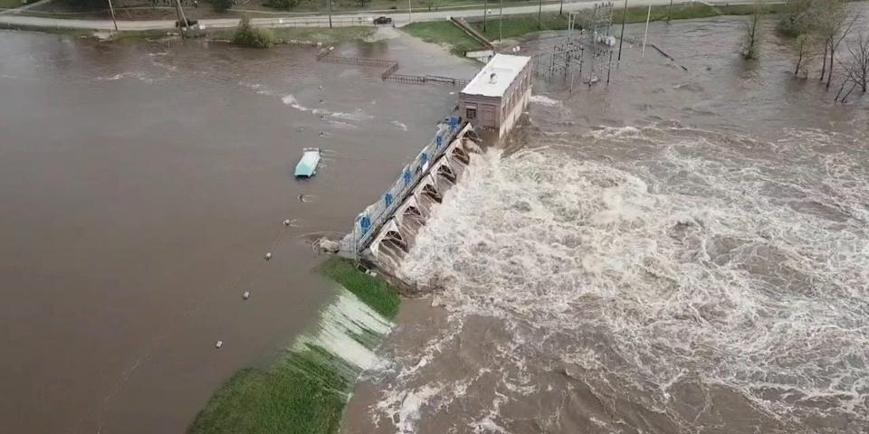 An aerial view of flooding as water overruns Sanford Dam, Michigan, in this May 19, 2020, still frame obtained from social-media video.