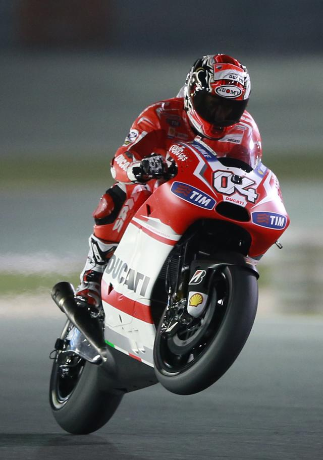 Ducati Team MotoGP rider Andrea Dovizioso of Italy races during a free practice session at the MotoGP World Championship at the Losail International circuit in Doha March 22, 2014. REUTERS/Mohammed Dabbous (QATAR - Tags: SPORT MOTORSPORT)