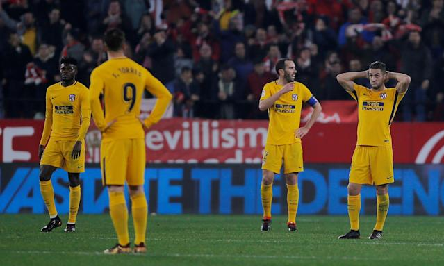 Soccer Football - Spanish King's Cup - Quarter Final Second Leg - Sevilla vs Atletico Madrid - Ramon Sanchez Pizjuan, Seville, Spain - January 23, 2018 Atletico Madrid's Diego Godin and team mates react after conceding their third goal REUTERS/Jon Nazca