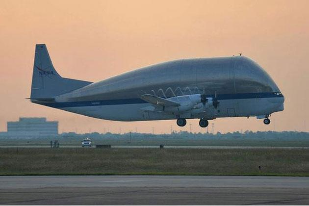 NASA's Super Guppy cargo aircraft takes off from Ellington Field in Houston carrying NASA's space shuttle trainer crew cabin on June 27, 2012. The cargo is bound for The Museum of Flight in Seattle, Wash.