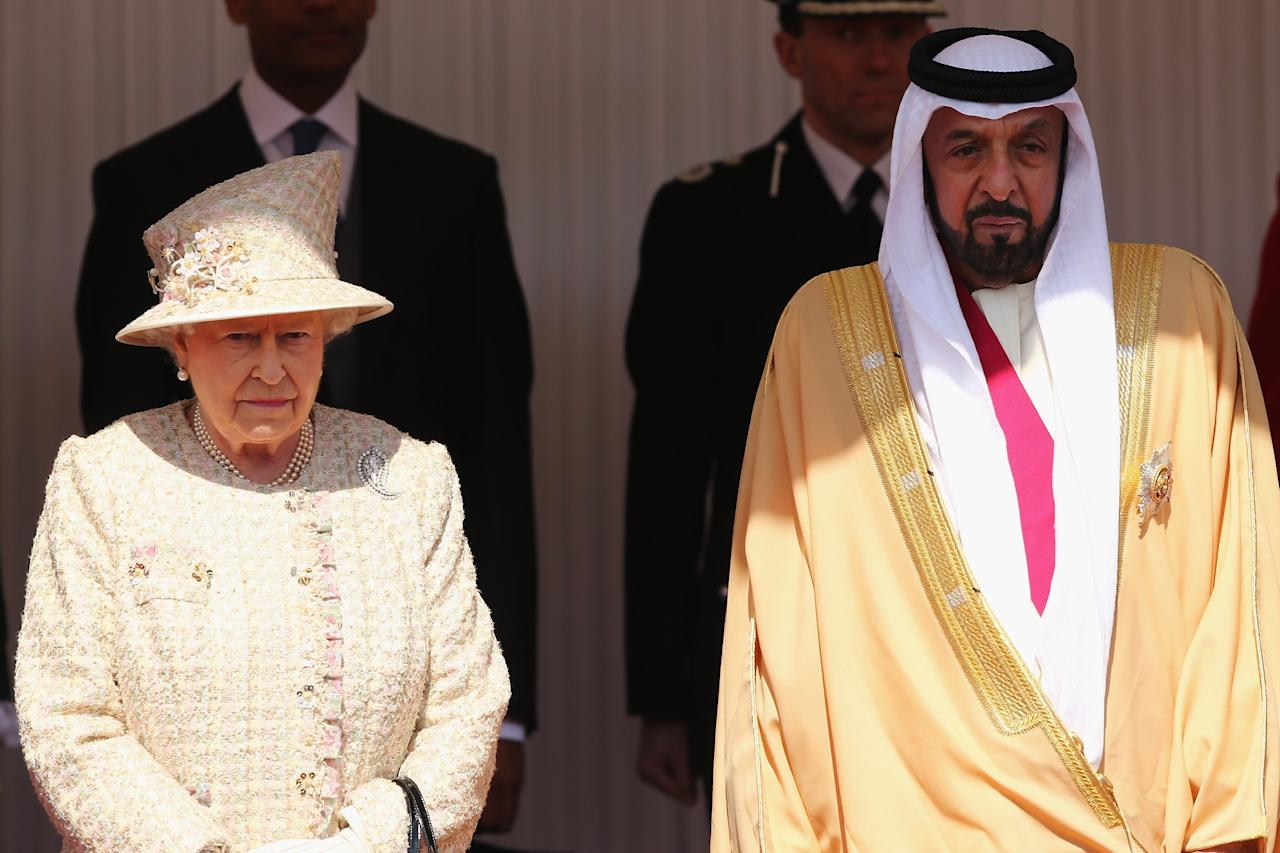 WINDSOR, ENGLAND - APRIL 30:  Queen Elizabeth II poses with The President of the United Arab Emirates, His Highness Sheikh Khalifa bin Zayed Al Nahyan on the Royal Dais on April 30, 2013 in Windsor, England. President Sheikh Khalifa begins a State visit to the UK today, the first for a UEA President in 24 years. Sheikh Khalifa will meet the British Prime Minister David Cameron tomorrow at his Downing Street residence.  (Photo by Dan Kitwood/Getty Images)