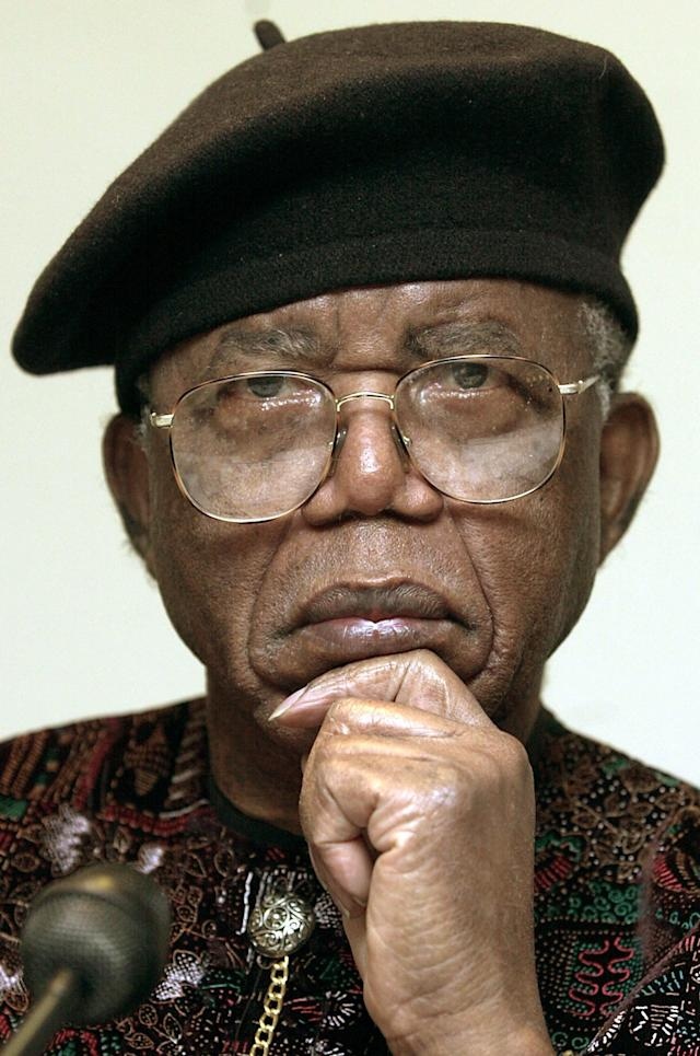 """FILE - In this Oct. 12, 2002 file photo, Nigerian writer Chinua Achebe is shown in Frankfurt Main, Germany. Achebe, who wrote the classic, """"Things Fall Apart,"""" has died. He was 82. Achebe's publisher confirmed his death Friday, March 22, 2013. (AP Photo/dpa, Frank May, File)"""