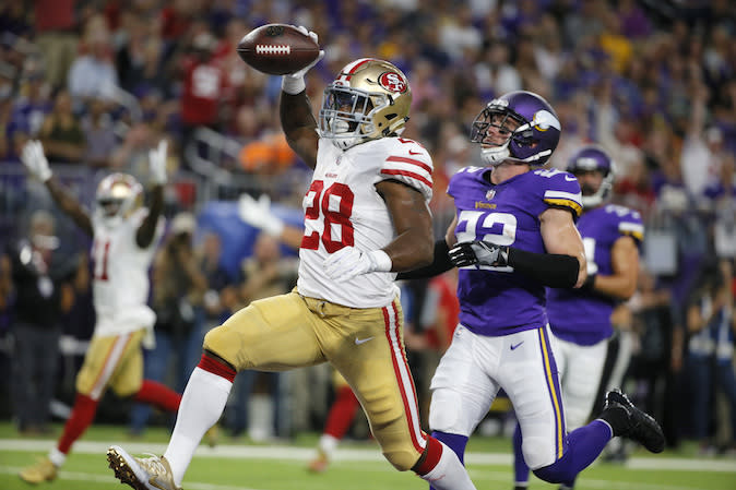 San Francisco 49ers running back Carlos Hyde catches a 24-yard touchdown pass in front of Minnesota Vikings free safety Harrison Smith, right, during the first half of an NFL preseason football game Sunday, Aug. 27, 2017, in Minneapolis. (AP Photo/Bruce Kluckhohn)
