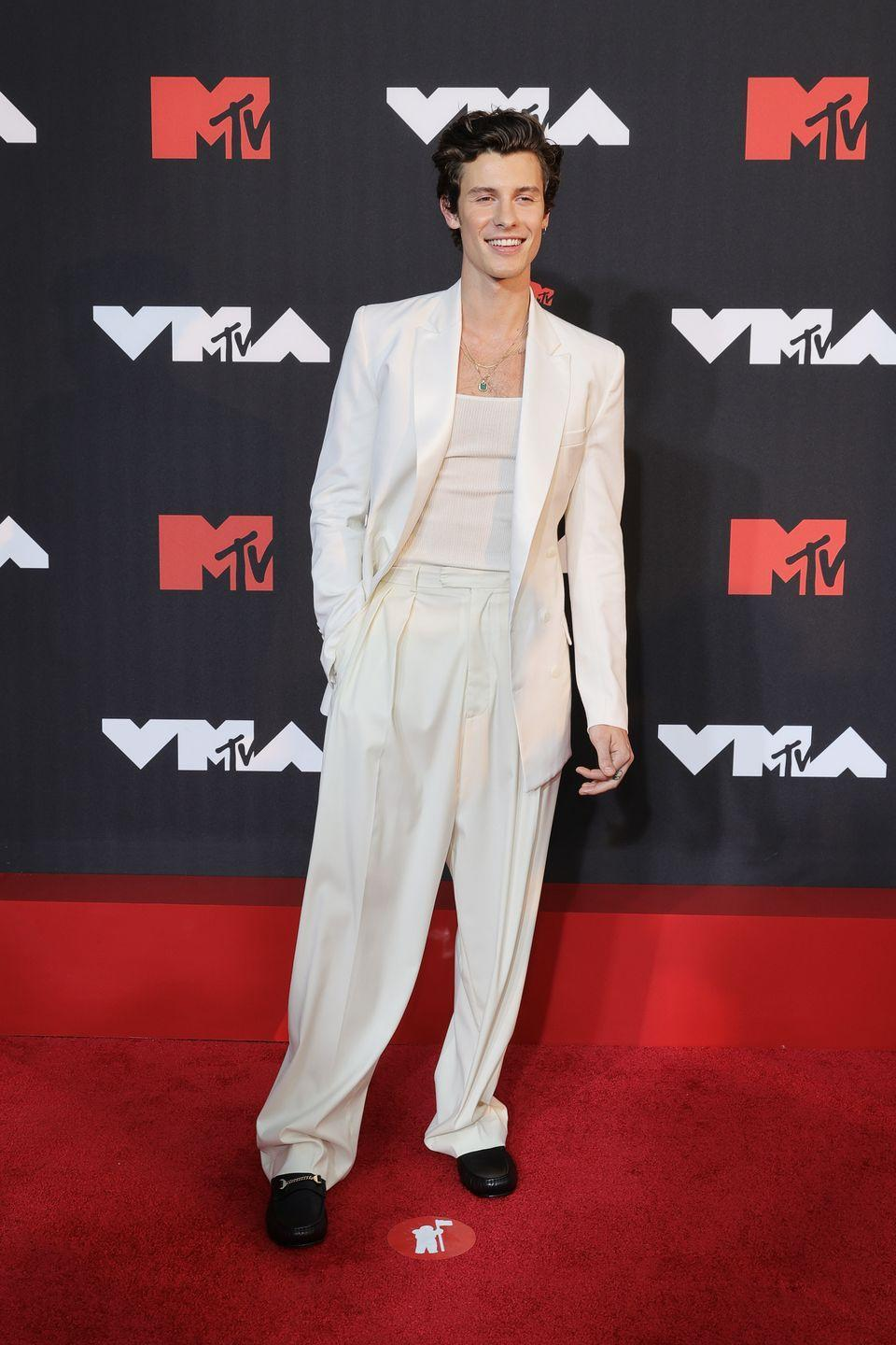 <p>Mendes wore a cream suit and loose-fitted trousers. </p>