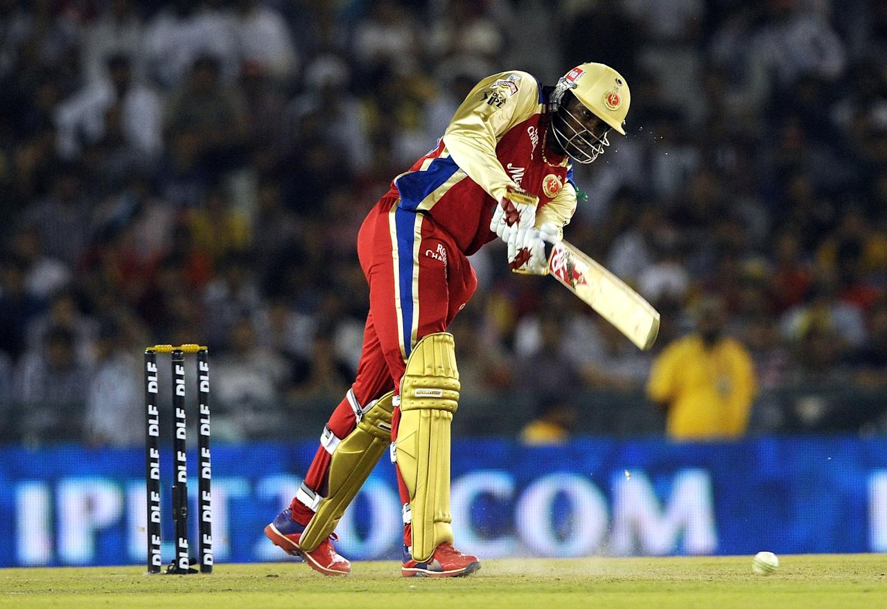 Royal Challengers Bangalore batsman Chris Gayle plays a shot during the IPL Twenty20 cricket match between Kings XI Punjab and Royal Challengers Bangalore at PCA Stadium in Mohali on April 20, 2012.  RESTRICTED TO EDITORIAL USE. MOBILE USE WITHIN NEWS PACKAGE    AFP PHOTO/ Prakash SINGH (Photo credit should read PRAKASH SINGH/AFP/Getty Images)