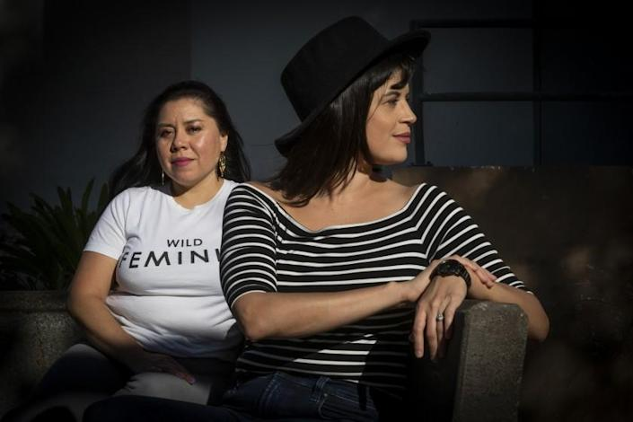 "TV writers Diana Mendez, left, and Judalina Neira formed the Latina TV Writers Brunch Group and La Lista to represent the Latina community in Hollywood. <span class=""copyright"">(Gina Ferazzi / Los Angeles Times)</span>"