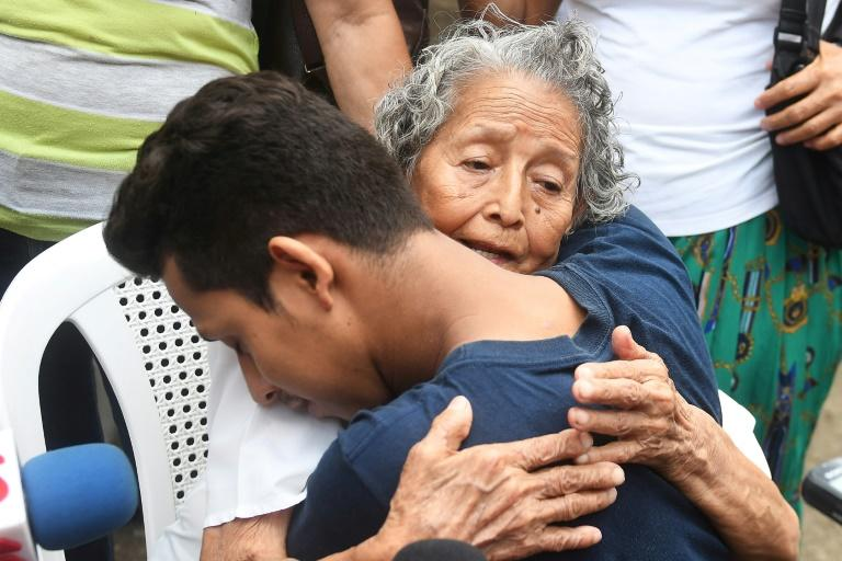 A Nicaraguan man arrested in recent protests is embraced by a relative after being released from jail in Managua, after intervention by Catholic bishops