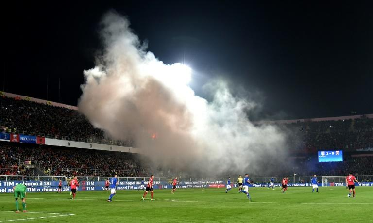 Albania's supporters throw smoke bombs and flares during the FIFA World Cup 2018 qualification football match against Italy March 24, 2017