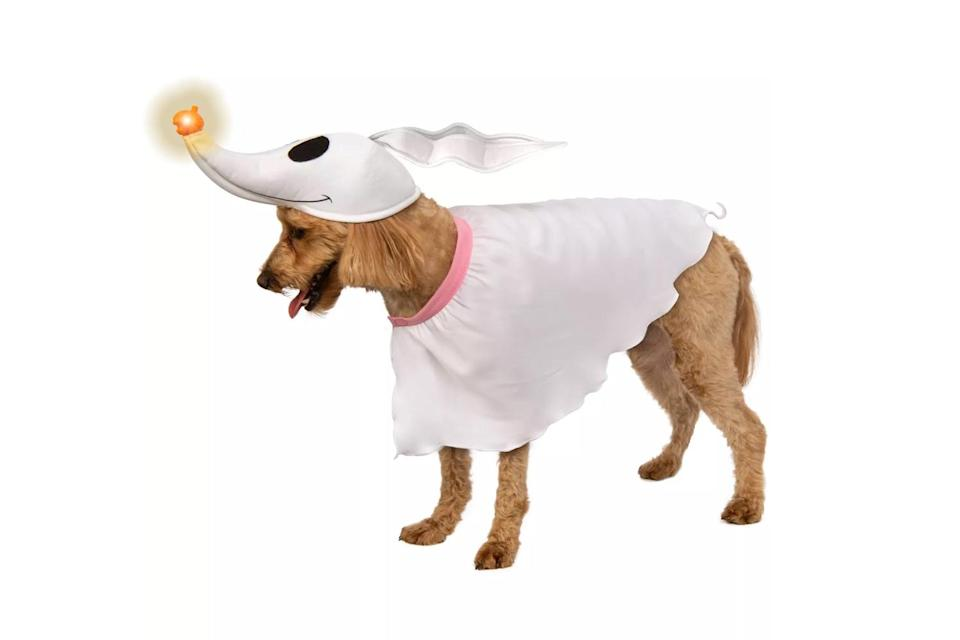"""<p>Let your dog lead the way on Halloween night with this light-up <em>The Nightmare Before Christmas</em> costume. </p> <p><strong>Buy it!</strong> Disney Nightmare Before Xmas Zero Dog Costume, $15.99; <a href=""""https://goto.target.com/c/249354/81938/2092?subId1=PEO25HalloweenCostumesforDogsthatWillHaveTrickorTreatersHowlingwithJoykbender1271PetGal12909733202109I&u=https%3A%2F%2Fwww.target.com%2Fp%2Fdisney-nightmare-before-xmas-zero-dog-costume%2F-%2FA-82088416"""" rel=""""sponsored noopener"""" target=""""_blank"""" data-ylk=""""slk:Target.com"""" class=""""link rapid-noclick-resp"""">Target.com</a></p>"""