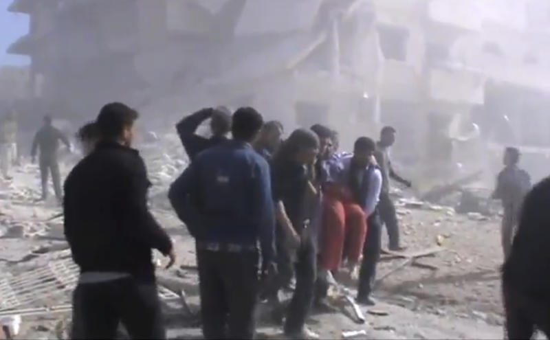 This image taken from video obtained from the Shaam News Network, which has been authenticated based on its contents and other AP reporting, shows attempts to rescue the wounded of the city following heavy bombing from military warplanes in Idlib, northern Syria, on Monday Oct. 29, 2012. Syrian warplanes launched 60 airstrikes against rebel targets around the country on Monday, the most intense air raids across the country since the uprising began 19 months ago, according to anti-regime activists. Activists said at least 500 people were killed over the four-day period ending Monday when a U.N.-backed truce was supposed to be in effect. They said the death toll for Monday so far has reached 80. (AP Photo/Shaam News Network via AP video)