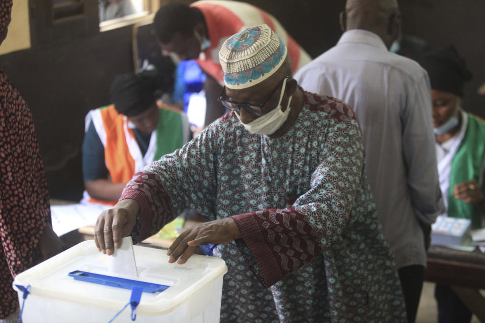 People cast their vote in presidential election in Abidjan, Ivory Coast, Saturday, Oct. 31, 2020. Tens of thousands of security forces deployed across Ivory Coast on Saturday as the leading opposition parties boycotted the election, calling President Alassane Ouattara's bid for a third term illegal. (AP Photo/Diomande Ble Blonde)