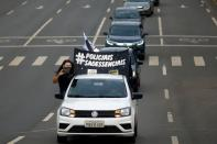 Police officers take part in a motorcade during a protest against Brazil's President Jair Bolsonaro, in Brasilia