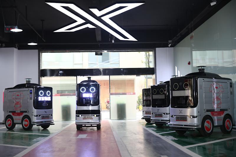 JD's autonomous delivery robots in a garage.