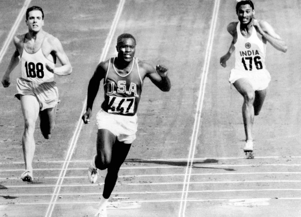 FILE - In this Sept. 5, 1960, file photo, Rafer Johnson of the United States, center, finishers the fourth heat of the decathlon 100 meter dash at the Olympics in Rome, Italy. Eef Kamerbeek of Netherlands is at left, and Gurbachan Singh Randhawa of India is at right. Rafer Johnson, who won the decathlon at the 1960 Rome Olympics and helped subdue Robert F. Kennedy's assassin in 1968, died Wednesday, Dec. 2, 2020. He was 86. He died at his home in the Sherman Oaks section of Los Angeles, according to family friend Michael Roth. (AP Photo/Olympic Pool, File)