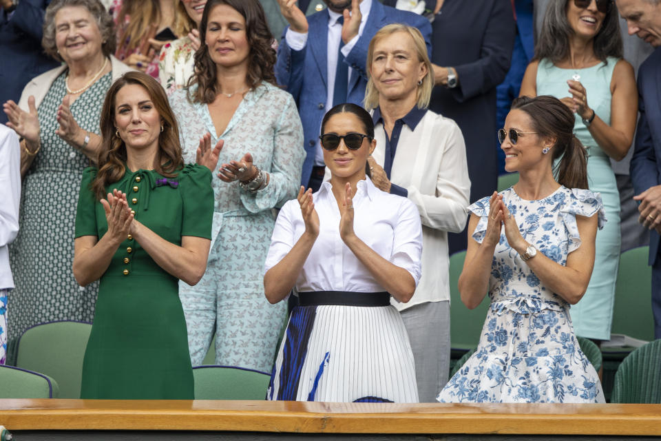 LONDON, ENGLAND - July 13:   Catherine, Duchess of Cambridge and Meghan, Duchess of Sussex and Pippa Middleton in the Royal Box on Centre Court applaud the winner Simona Halep of Romania after her victory against Serena Williams of the United States during the Ladies Singles Final on Centre Court during the Wimbledon Lawn Tennis Championships at the All England Lawn Tennis and Croquet Club at Wimbledon on July 13, 2019 in London, England. (Photo by Tim Clayton/Corbis via Getty Images)