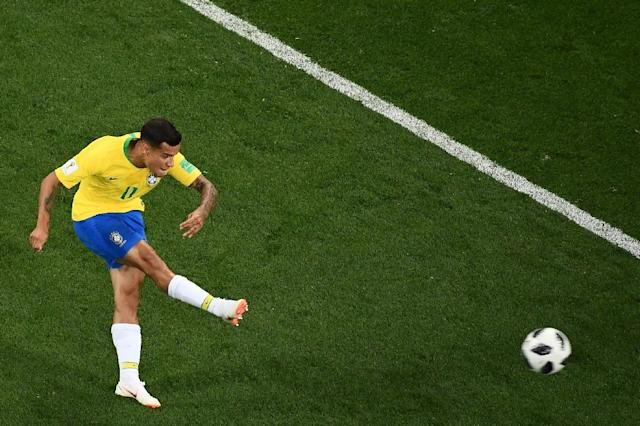 Off to a flyer: Philippe Coutinho scored Brazil's first goal of the World Cup (AFP Photo/Jewel SAMAD)