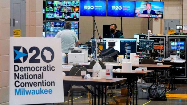 PHOTO: People work in the control room for the Democratic National Convention before the start of the convention at the Wisconsin Center in Milwaukee, Aug. 17, 2020. (Morry Gash/Pool via AFP/Getty Images)