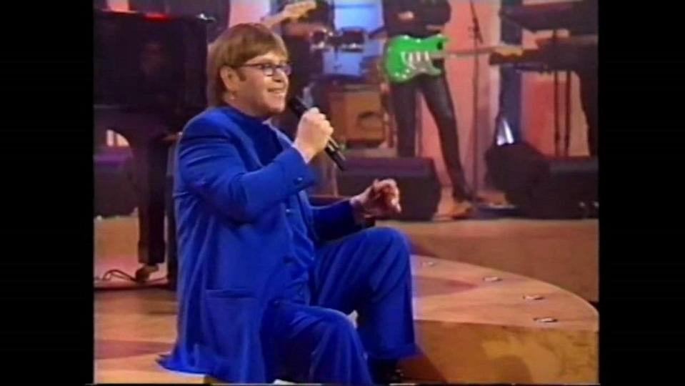 Elton John answers questions and performs for fans in his 1997 TV special.