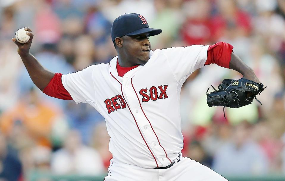 Boston Red Sox's Rubby De La Rosa pitches during the first inning of a baseball game against the Minnesota Twins in Boston, Monday, June 16, 2014. (AP Photo/Michael Dwyer)