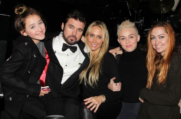 Billy Ray Cyrus poses with his family backstage at the hit musical 'Chicago' on Broadway at The Ambassador Theater in New York City on November 18, 2012 -- Getty Premium