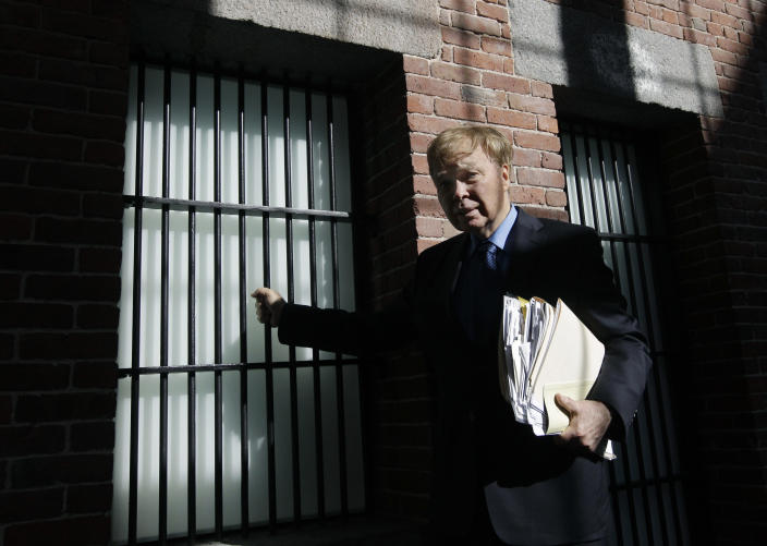 In this April 5, 2012 photo, birth control pioneer Bill Baird, 79, poses by the bars of an old Charles Street Jail cell, currently in the lobby of the Liberty Hotel, in Boston. Forty-five years ago, Baird's arrest for giving spermicidal foam to an unmarried 19-year-old coed set up a constitutional challenge that sent his case to the U.S. Supreme Court. (AP Photo/Elise Amendola)