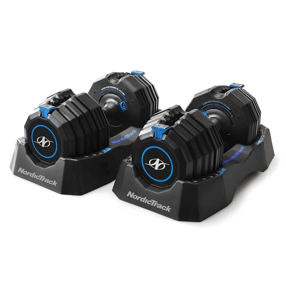 """<p><strong>NordicTrack</strong></p><p>nordictrack.com</p><p><strong>$599.00</strong></p><p><a href=""""https://go.redirectingat.com?id=74968X1596630&url=https%3A%2F%2Fwww.nordictrack.com%2Fstrength%2Fselect-a-weight-55-lb-dumbbell-set&sref=https%3A%2F%2Fwww.runnersworld.com%2Fgear%2Fg36483327%2Fadjustable-dumbbells%2F"""" rel=""""nofollow noopener"""" target=""""_blank"""" data-ylk=""""slk:Buy Now"""" class=""""link rapid-noclick-resp"""">Buy Now</a></p><p>If you're looking to lift a decent amount of weight and have some range to go from lighter tricep kickbacks to a heavier chest presses, consider this set of adjustable weights. It offers 15 different loads from 10 pounds to 55 pounds on each dumbbell. Two holders come included, and we found them easy to adjust—simply lift the blue selector, slide it to the desired weight load, and release it. We were able to perform supersets, changing the weight quickly between exercises. The weights are compact, which is important when you're using them for multiple exercises or at home when you don't have a ton of space.</p>"""